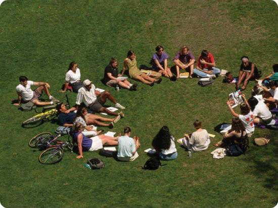 students-sitting-in-circle-outside-on-lawn_rounded_corners